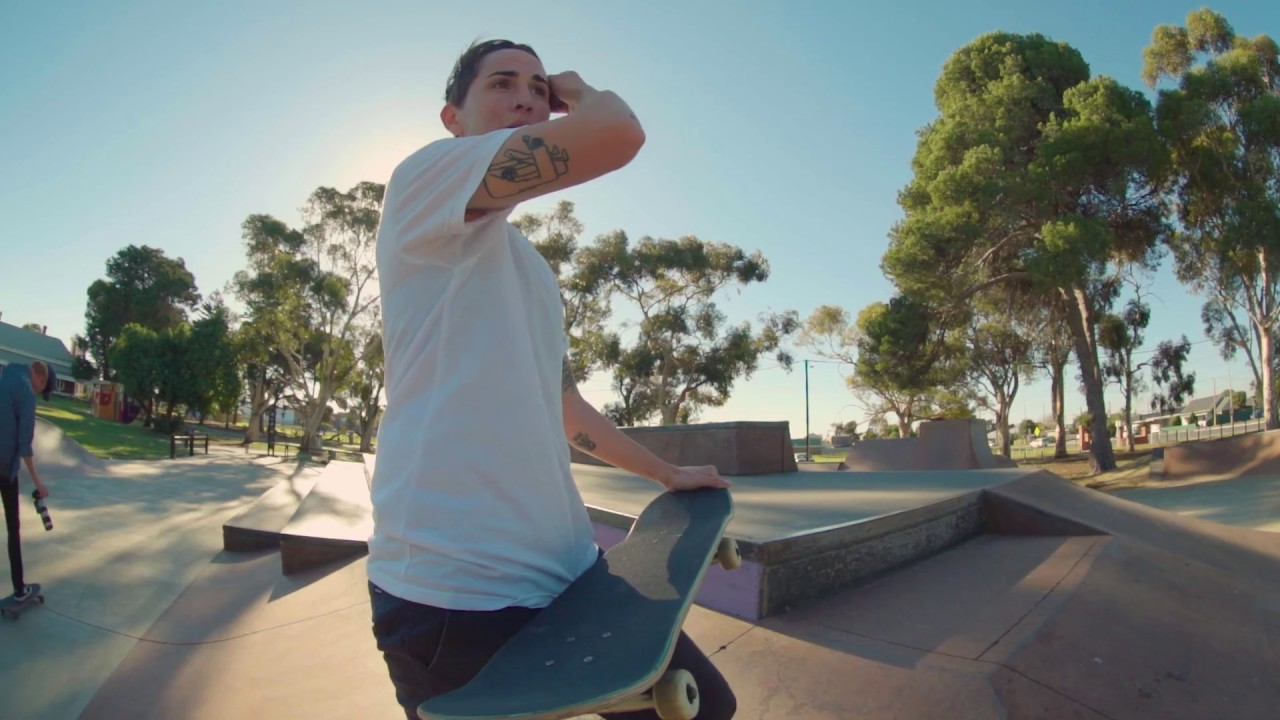 Skater Kat Williams wipes sweat from brow at skate park