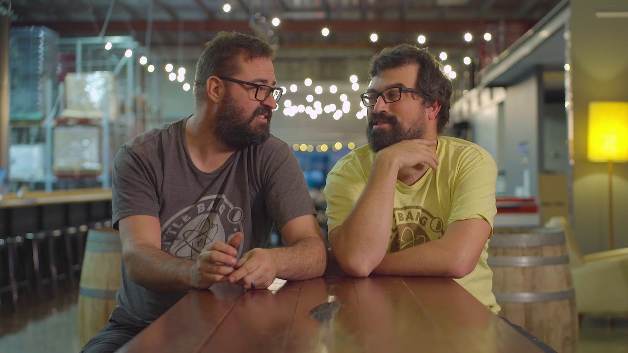 Wild savers, Fil and Ryan, chat to each other inside Little Bang brewery