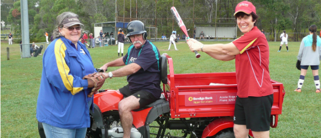 Acacia Ridge directors on the softball pitch with a new tractor trailer sponsored by the local Acacia Ridge Community Bank.