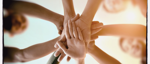 picture of community hand linked together