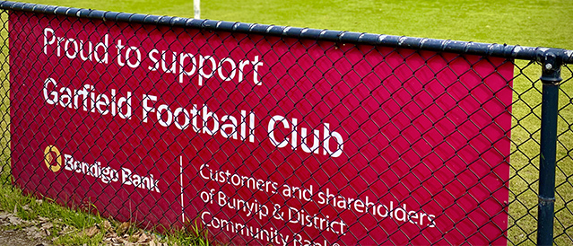 Bendigo Bank sponsorship sign attached to a fence at Garfield Football Club