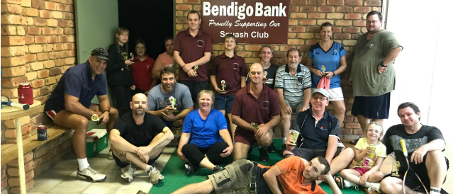 Squash club members in front of a Bendigo Bank sign in their clubrooms after receiving a grant from South Grafton Community Bank Branch.