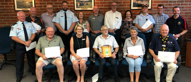 Community group photo of defibrillator presentation to local organisations in Dandenong Ranges area.