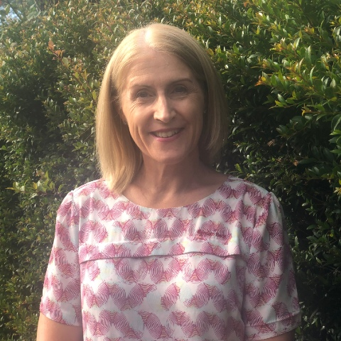 Image of Jacquie, Customer Service Officer of Busselton and Dunsborough Community Bank branches of Bendigo Bank, standing outdoors with trees in the background.