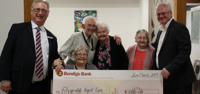 Fitzgerald House grant recipients pictured with novelty cheque and branch representatives.