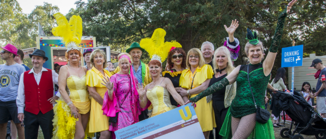People dressed in colourful outfits participating in a community event supported by Heidelberg Community Bank Branch.