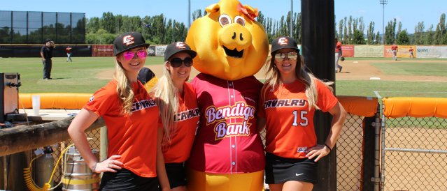 Calwell Community Bank Branch mascot, a big yellow pig, with Australian Baseball League members.