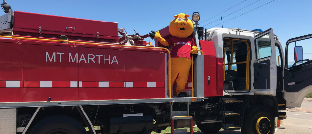 Mount Martha Community Bank Branch mascot, a big yellow pig, on a CFA truck which has been funded by the local branch.