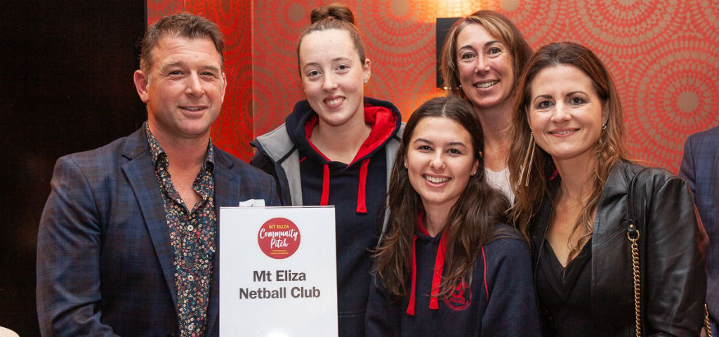 Local community members from Mt Eliza Netball Club celebrating local investment through the Mt Eliza Community Pitch Program.