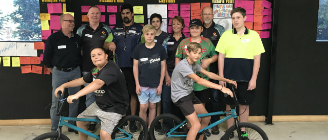 Victoria Point Community Bank Branch directors with young people on bikes from a youth group called Traction.