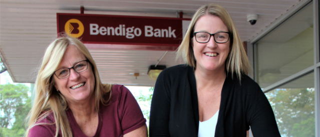 Bendigo Bank's Jo Winter and manager, Simone Flavelle happily reminding everyone the Cooroy Community Bank branch isn't going anywhere.