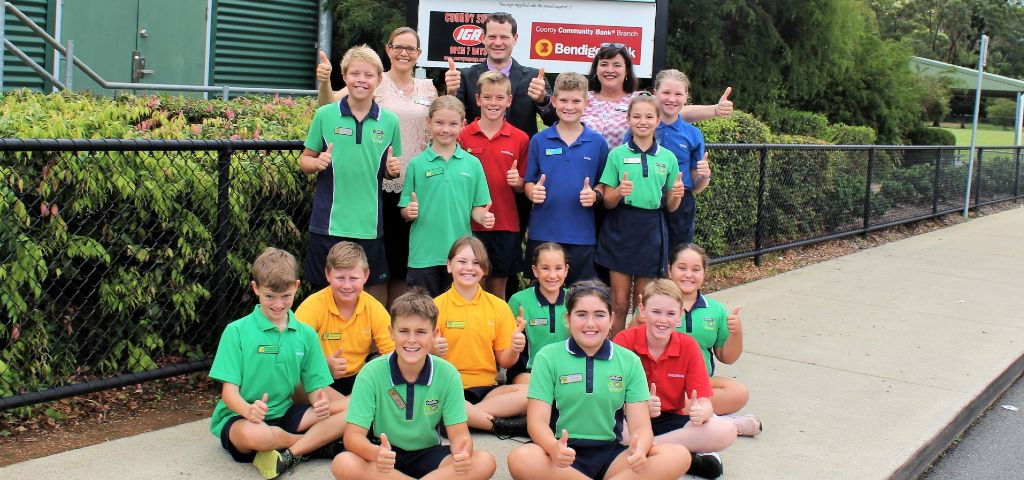 Some year 6 students from Cooroy state school with principal Matt and branch manager Sam
