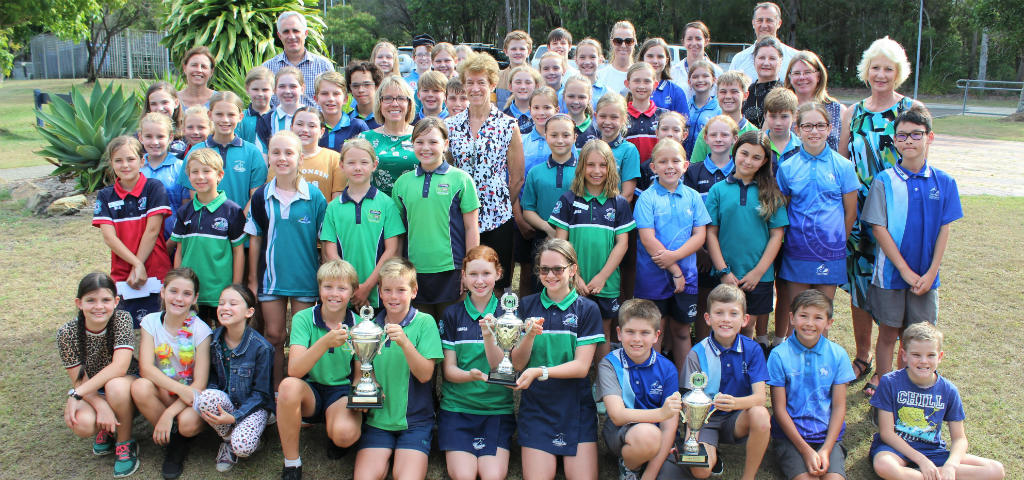 Branch staff join students from Noosaville, Tewantin, Cooroy and Cooran State Schools pictured in uniform.