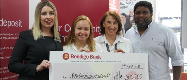 Windsor Community Bank Branch of Bendigo Bank branch staff presenting scholarship students with a novelty cheque