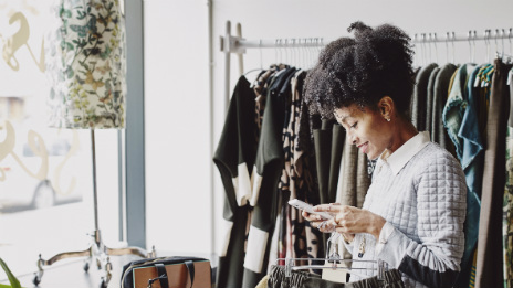 Young woman working in a clothing store.