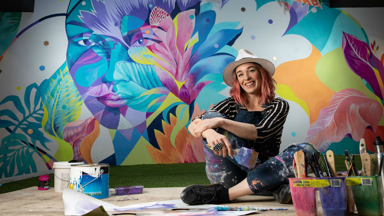 Accomplished international artist, Shannon Crees at the completion of her latest large scale mural work in our new Leichhardt branch.